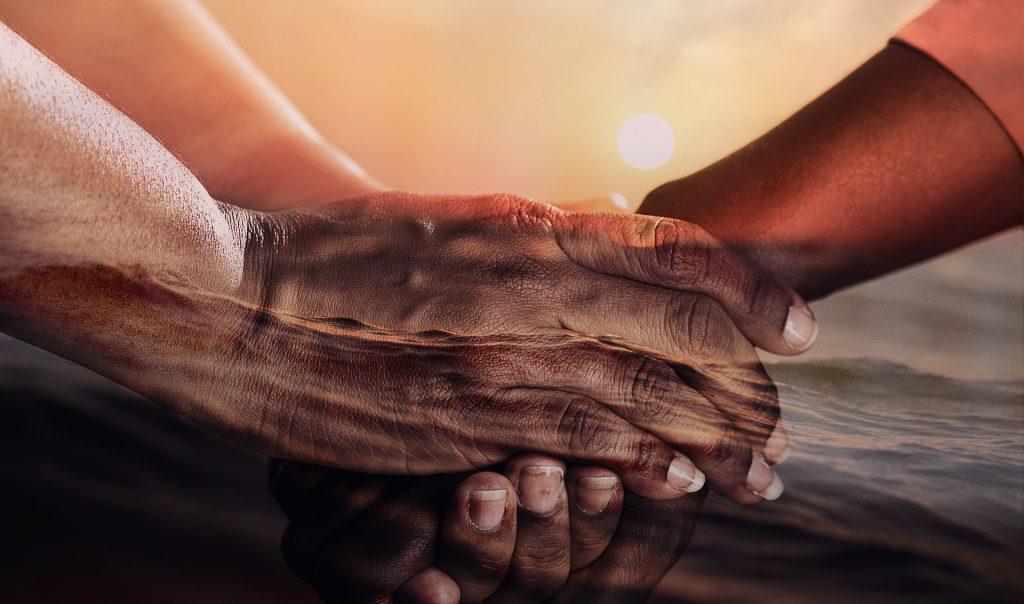 Hände, die sich berühren